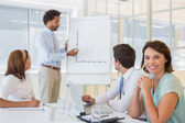 Businesswoman with colleagues in boardroom meeting — Stock Photo