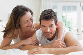 Portrait of a relaxed couple lying in bed — Stock Photo