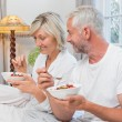 Mature couple having breakfast in bed — Stock Photo #42590289