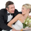 Happy bride and groom looking at each other — Stock Photo