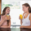 Happy friends drinking orange juice at cafe — Stock Photo #42591291