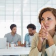 Close-up of serious businesswoman with colleagues in meeting — Stock Photo #42592371