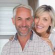 Close-up of a happy mature couple at home — Stock Photo #42592599