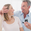 Man surprising happy woman with a wedding ring — Stock Photo #42592885