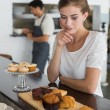 Cafe owner with sweet food at counter — Stock Photo #42593165