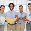 Business colleagues holding folders in office — Stock Photo #42593245