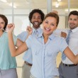 Cheerful business colleagues cheering in office — Stock Photo #42593363