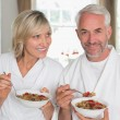 Portrait of a mature couple having breakfast — Stock Photo