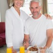 Mature couple having breakfast at home — Stock Photo #42594753