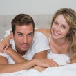 Close-up of a loving couple lying in bed — Stock Photo #42594827