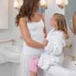 Mother and daughter in the bathroom — Stock Photo