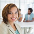 Close-up of smiling businesswoman with colleagues in meeting — Stock Photo #42595409