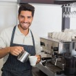 Waiter smiling and making cup of coffee at coffee shop — Stock Photo