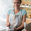 Barista using credit card at counter in coffee shop — Stock Photo