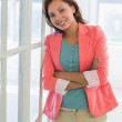 Portrait of a confident businesswoman with arms crossed at office — Stock Photo