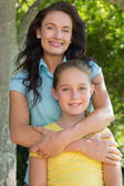 Mother and daughter standing in park — Stock Photo