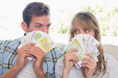 Close-up of a young couple holding Euro notes — Stock Photo