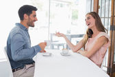 Side view of a smiling couple at coffee shop — Stockfoto