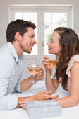 Loving couple with wine glasses looking at each other — Stock Photo