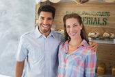 Couple with arm around at the bakery — Stock Photo