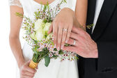Newly wed couple showing wedding rings — Stock Photo