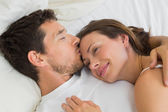 Relaxed couple sleeping together in bed — Stock Photo