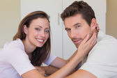 Side view portrait of loving couple at home — Stock Photo