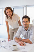 Two colleagues working on blueprints at office — Stock Photo