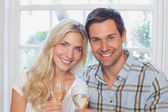 Close-up of a happy loving couple with wine glasses — Stock Photo