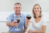 Portrait of a couple holding wine glasses — Stock Photo
