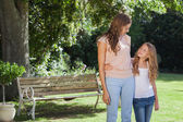 Cute smiling girl and mother in park — Foto Stock