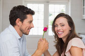 Man giving happy woman a rose — Stock Photo