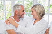 Loving happy mature couple with arm around — Stock Photo