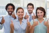Współpracownikami gestykulacji kciuk w górę — Zdjęcie stockowe