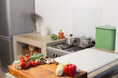 Raw vegetables on kitchen counter — Stok fotoğraf
