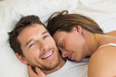 Close-up of a loving couple lying in bed — Stock Photo