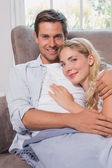 Portrait of a relaxed loving couple lying on sofa — Stock Photo