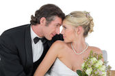 Loving newly wed couple with head to head — Stock Photo