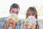 Close-up portrait of a young couple holding Euro notes — Stock Photo