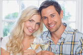 Happy loving young couple with wine glasses — Stock Photo