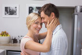Happy loving young couple in the kitchen — Stock Photo