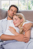 Relaxed loving couple sleeping together on sofa — Stock Photo