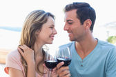 Loving young couple toasting wine glasses — Stock Photo