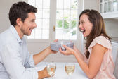 Man giving happy woman a gift box at home — Foto de Stock