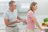 Unhappy couple having an argument in kitchen — ストック写真
