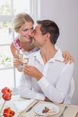 Happy couple with wine glasses having food — Stock Photo