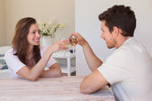 Happy young couple toasting wine glasses — Stock Photo