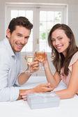 Portrait of a loving couple toasting wine glasses — Stock Photo