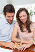 Couple with wine glass at home — Stock Photo