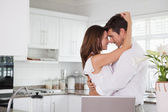 Loving couple looking at each other in kitchen — Stock Photo